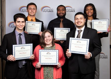 six students holding scholarship certificates